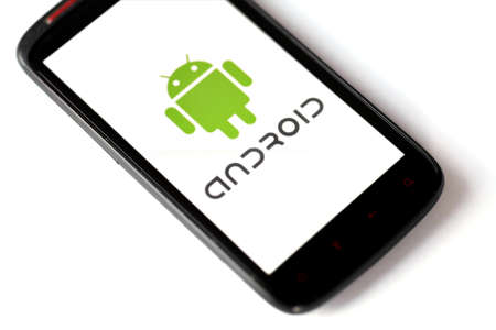 Bucharest, Romania - March 28, 2012: Close-up shot of an Android smartphone with the Android logo displayed on the screen. Android is a software stack for mobile devices that includes an operating system, middle-ware and key applications.  Stock Photo - 13154937