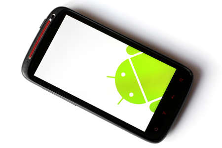operating key: Bucharest, Romania - March 28, 2012: Close-up shot of an Android smartphone with the Android logo displayed on the screen. Android is a software stack for mobile devices that includes an operating system, middle-ware and key applications.