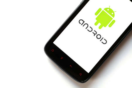 Bucharest, Romania - March 28, 2012: Close-up shot of an Android smartphone with the Android logo displayed on the screen. Android is a software stack for mobile devices that includes an operating system, middle-ware and key applications.  Stock Photo - 13154939