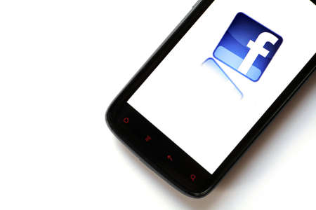 Bucharest, Romania - March 28, 2012: Facebook logo is displayed on a mobile phone screen. Facebook is a social networking service launched in February 2004, having more than 845 million active users. Stock Photo - 13154943