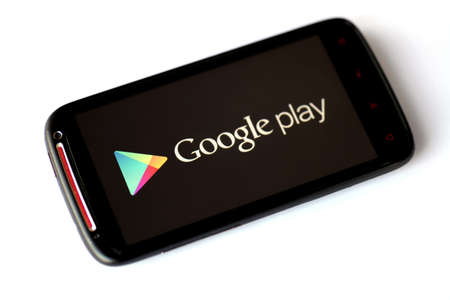 Bucharest, Romania - March 28, 2012: Google Play logo is displayed on a mobile phone screen. Google Play is a digital multimedia content service from Google which includes an online as well as a cloud media player.