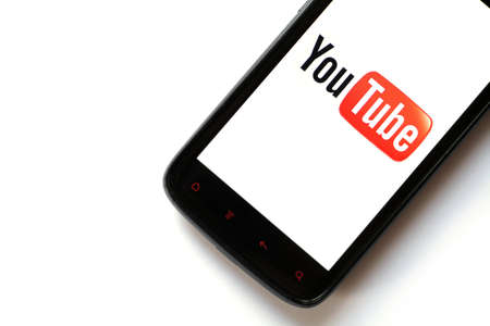Bucharest, Romania - March 28, 2012: Youtube logo is displayed on a mobile phone screen. YouTube is a video-sharing website, on which users can upload, view and share videos. Stock Photo - 13154944