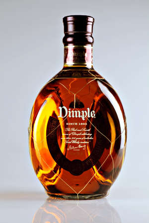 Bucharest, Romania - April 14, 2012: Close-up shot of a bottle of Dimple. Dimple is one of the most popular Blended Deluxe Scotch worldwide. Stock Photo - 13455785