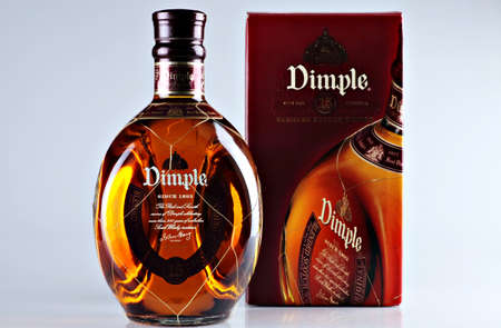 Bucharest, Romania - April 14, 2012: Close-up shot of a bottle of Dimple. Dimple is one of the most popular Blended Deluxe Scotch worldwide.