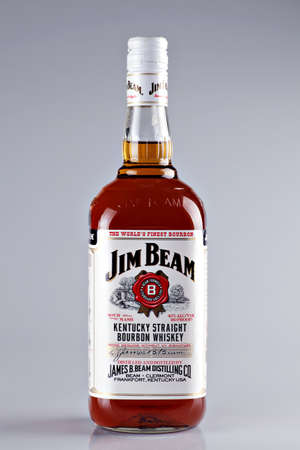 Bucharest, Romania - April 14, 2012: Close-up shot of a bottle of Jim Beam bourbon whiskey. Jim Beam is a brand of bourbon whiskey, currently one of the best selling brands of bourbon in the world.