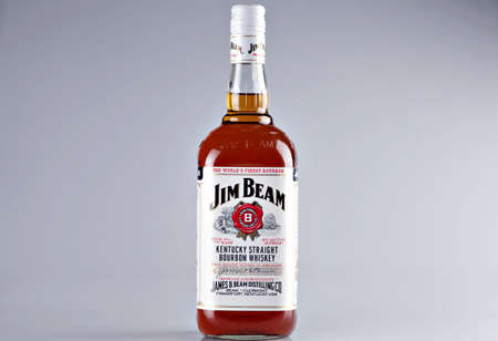 jim: Bucharest, Romania - April 14, 2012: Close-up shot of a bottle of Jim Beam bourbon whiskey. Jim Beam is a brand of bourbon whiskey, currently one of the best selling brands of bourbon in the world. Editorial