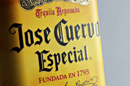 Bucharest, Romania - April 13, 2012: Close-up shot of a bottle of Jose Cuervo tequila. JosŽ Cuervo is a brand of tequila produced by Tequila Cuervo La Rojena and it has the highest sales of any tequila brand in the world.