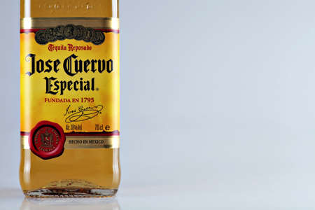 Bucharest, Romania - April 14, 2012: Close-up shot of a bottle of Jose Cuervo tequila. Jos� Cuervo is a brand of tequila produced by Tequila Cuervo La Rojena and it has the highest sales of any tequila brand in the world.