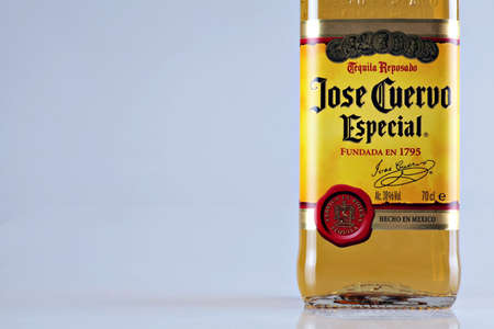 Bucharest, Romania - April 14, 2012: Close-up shot of a bottle of Jose Cuervo tequila. JosŽ Cuervo is a brand of tequila produced by Tequila Cuervo La Rojena and it has the highest sales of any tequila brand in the world.