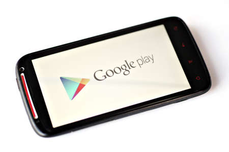 google play: Bucharest, Romania - March 28, 2012: Google Play logo is displayed on a mobile phone screen. Google Play is a service from Google which includes an online store for music, movies, books, and Android apps and games. Editorial