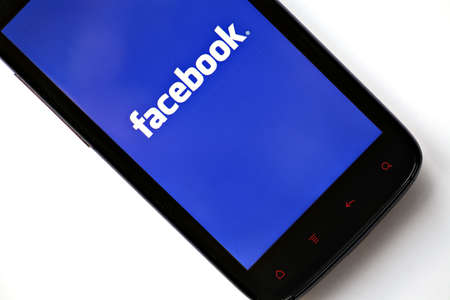 Bucharest, Romania - March 28, 2012: Facebook logo is displayed on a mobile phone screen. Facebook is a social networking service launched in February 2004, having more than 845 million active users. Stock Photo - 13455795