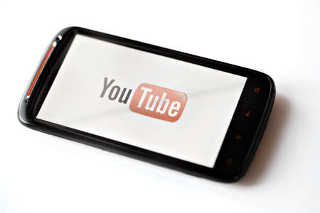 Bucharest, Romania - March 28, 2012: Youtube logo is displayed on a mobile phone screen. YouTube is a video-sharing website, on which users can upload, view and share videos.