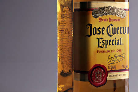 Bucharest, Romania - April 13, 2012: Close-up shot of a bottle of Jose Cuervo tequila. Jos� Cuervo is a brand of tequila produced by Tequila Cuervo La Rojena and it has the highest sales of any tequila brand in the world.