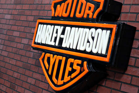 displayed: Bucharest, Romania - April 22, 2012: Harley Davidson logo is displayed on a wall during a motorcycle exhibition in Bucharest, Romania. Editorial