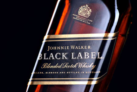 Bucharest, Romania - April 17, 2012: Close-up shot of a bottle of Johnnie Walker whiskey. Johnnie Walker is a brand of Scotch Whisky owned by Diageo and originated in Kilmarnock, Ayrshire, Scotland. Stock Photo - 13574860