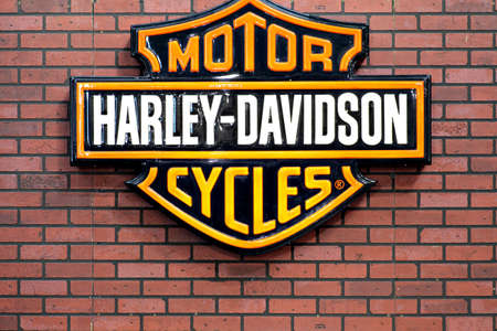 harley davidson motorcycle: Bucharest, Romania - April 22, 2012: Harley Davidson logo is displayed on a wall in Bucharest, Romania. Harley Davidson is an American motorcycle manufacturer. Editorial