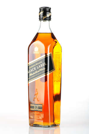 editorial: Bucharest, Romania - April 17, 2012: Close-up shot of a bottle of Johnnie Walker whiskey. Johnnie Walker is a brand of Scotch Whisky owned by Diageo and originated in Kilmarnock, Ayrshire, Scotland.