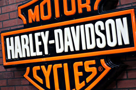 harley davidson: Bucharest, Romania - April 22, 2012: Harley Davidson logo is displayed on a wall during a motorcycle exhibition in Bucharest, Romania. Editorial