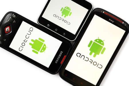Bucharest, Romania - April 29, 2012: Close-up shot of three Android smartphones, Samsung Galaxy S, Motorola Flipout and HTC Sensation XE, with the Android logo displayed on the screen. Android is a software stack for mobile devices that includes an operat