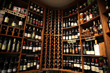 wine store: Bucharest, Romania - May 31, 2012: Wine bottles are displayed on shelves in a store in Bucharest, Romania.