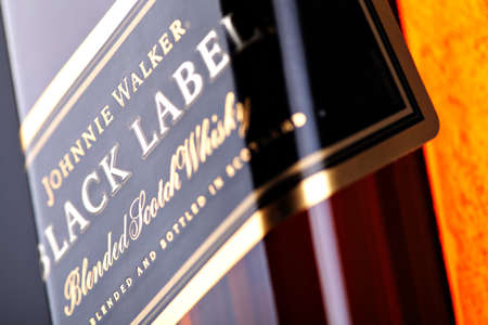 Bucharest, Romania - April 17, 2012: Close-up shot of a bottle of Johnnie Walker whiskey. Johnnie Walker is a brand of Scotch Whisky owned by Diageo and originated in Kilmarnock, Ayrshire, Scotland.