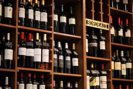 degustation: Bucharest, Romania - May 31, 2012: Wine bottles are displayed on shelves in a store in Bucharest, Romania.