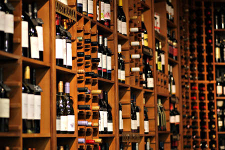 wine trade: Bucharest, Romania - May 31, 2012: Wine bottles are displayed on shelves in a store in Bucharest, Romania.