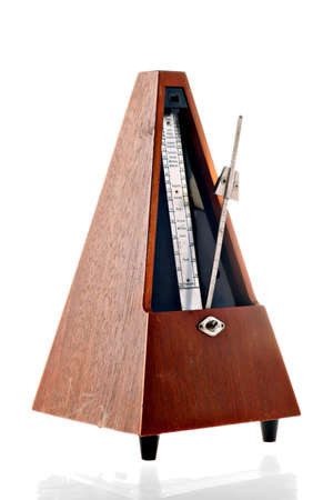 metronome: Vertical shot of a vintage metronome isolated on white Stock Photo