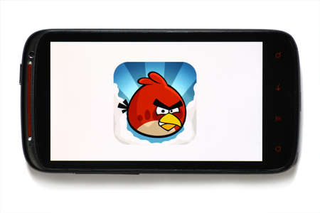 Bucharest, Romania - June 23, 2012: Android smartphone with the Angry Birds game logo displayed on the screen using a picture viewing software. Angry Birds is a puzzle video game developed by Finnish computer game developer Rovio Entertainment.