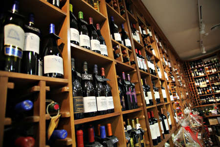 fruit trade: Bucharest, Romania - May 31, 2012: Wine bottles are displayed on shelves in a store in Bucharest, Romania.