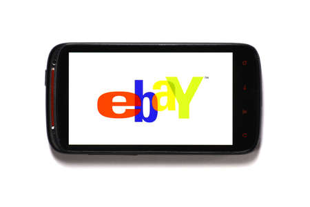 Bucharest, Romania - June 23, 2012: Android smartphone with the eBay logo displayed on the screen using a picture viewing software. eBay Inc. is an online auction and shopping website in which people and businesses buy and sell goods and services worldwid Stock Photo - 14818731