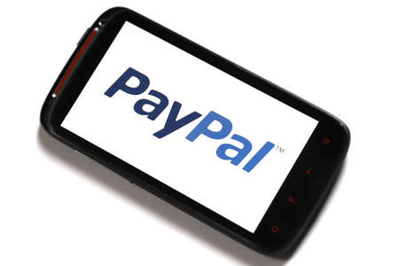 Bucharest, Romania - June 23, 2012: Android smartphone with the PayPal logo displayed on the screen using a picture viewing software. PayPal is the most popular online payment service, allowing payments and money transfers to be made through the Interne.