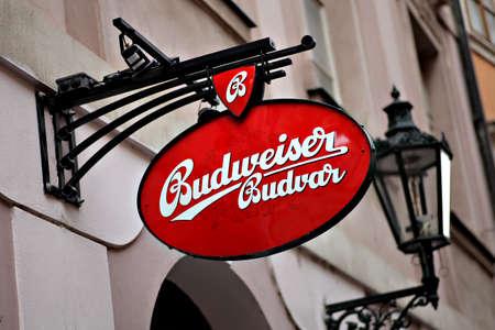 budweiser: Prague, Czech Republic - July 3, 2012: A Budweiser beer ad is seen in front of a pub in Prague, Czech Republic. Budweiser is a beer produced by the Belgian-Brazilian beer conglomerate Anheuser?usch InBev.