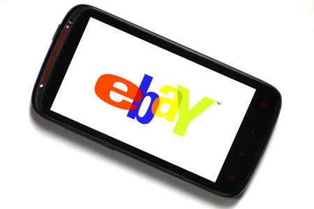 Bucharest, Romania - June 23, 2012: Android smartphone with the eBay logo displayed on the screen using a picture viewing software. eBay Inc. is an online auction and shopping website in which people and businesses buy and sell goods and services worldwid Stock Photo - 15079580