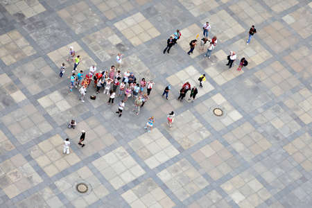 high angles: Prague, Czech Republic - July 3, 2012: A group of tourists is pictured from above in front of St.Vitus Cathedral in Prague, Czech Republic.  Editorial