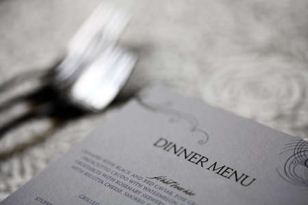 Close up shot of a dinner menu on a table photo