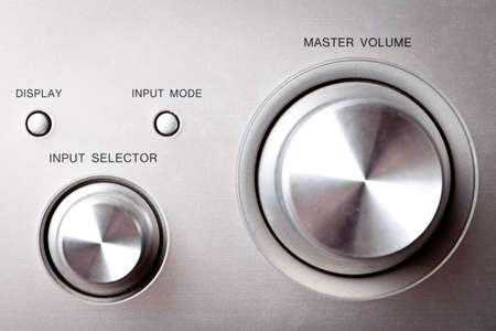 Horizontal shot of some hifi knobs from a stereo amplifier Stock Photo - 15375488