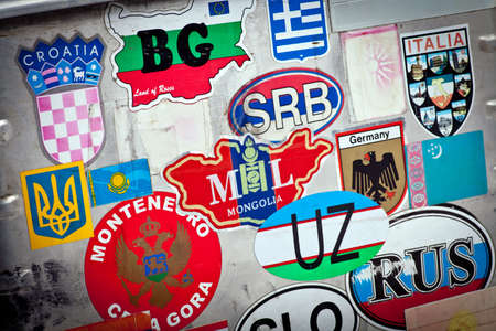 Country abbreviations stickers on a metal suitcase