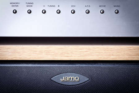 Bucharest, Romania - September 10, 2012: Horizontal shot of some knobs from a stereo amplifier with Jamo speakers. The Jamo brand, owned by Klipsch Group produces speakers and electronics. Stock Photo - 15486352