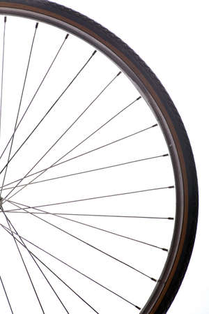 Close up shot of a bicycle wheel on white background photo