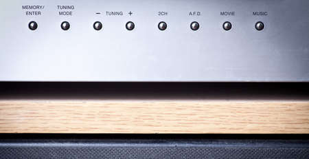 Horizontal shot of some knobs from a stereo amplifier. Stock Photo - 15738778