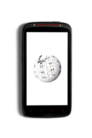 wikipedia: Bucharest, Romania - June 23, 2012: Android smartphone with the Wikipedia logo displayed on the screen using a picture viewing software. Wikipedia is a free, multilingual Internet encyclopedia.