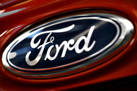 Bucharest, Romania - October 22, 2012: Ford logo is displayed on a car in Bucharest. Ford Motor Company is an American automaker with its headquarters in Dearborn, Michigan and was founded by Henry Ford.