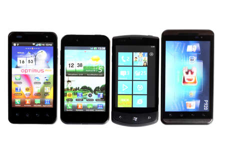 Bucharest, Romania - October 29, 2012: Four smartphones displayed in line, isolated on white, using various operating systems, like Windows Mobile or Android. Smartphones are mobile phones using advanced computing capability and connectivity.