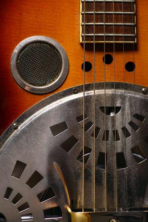 playing guitar: Color shot of a vintage dobro guitar
