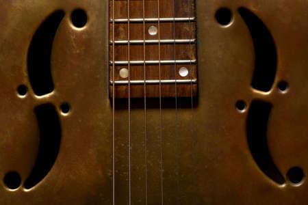 resonator: Color shot of a vintage dobro guitar