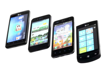 advanced computing: Bucharest, Romania - October 29, 2012: Four LG smartphones are displayed in line, isolated on white, using various operating systems, like Windows Mobile or Android. Smartphones are mobile phones using advanced computing capability and connectivity.