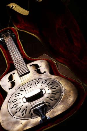 Color shot of a vintage guitar in a case