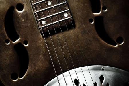 rock music: Color shot of an old vintage guitar