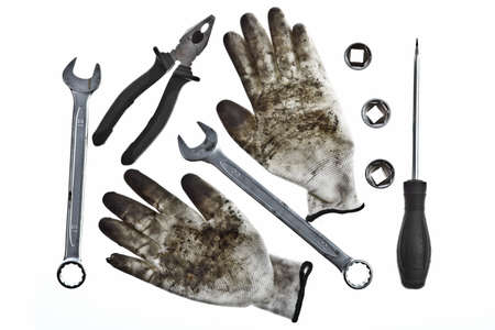 Various tools and a pair of dirty gloves Stock Photo - 17640808